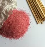 Suikerspinsuiker in de kleur roze, blauw, oranje of groen.