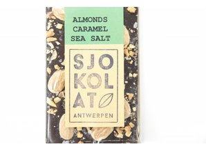 SJOKOLAT A bar of dark chocolate with almonds, caramel and seasalt