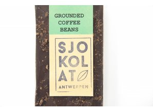 SJOKOLAT A bar of dark chocolate with roasted coffee beans
