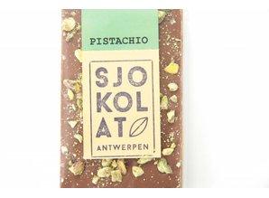 SJOKOLAT A bar of milk chocolate with pistachio nuts