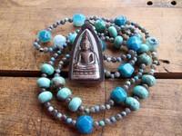 Les chaînes de pierres précieuses avec un charme bouddha belle chance