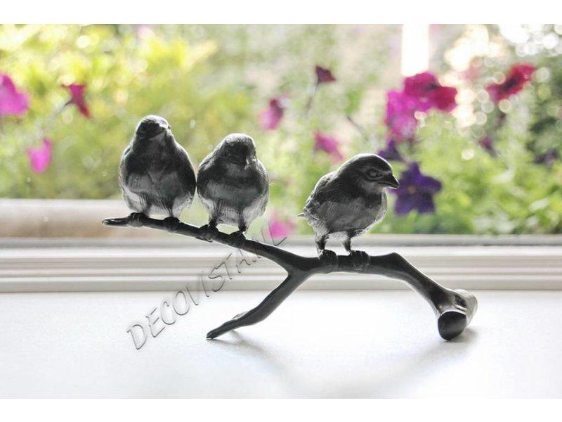 Bronzen takje met drie vogels