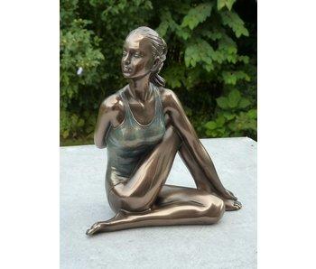 BodyTalk Yoga beeldje in yogapositie Ardha Matsyendrasana