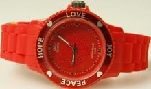 Goedkope Q&Q horloges kopen? Citizen dameshorloge rood (Love, Hope, Peace en Joy)