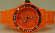 Goedkope Q&Q horloges kopen? Citizen ladies watch orange (Love, Hope, Peace and Joy)