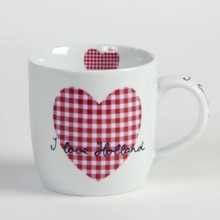 "White mugs with the text ""I love Holland"""