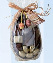 Chocolate easter egg standing in gift box with chocolates
