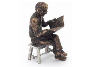 "Sculpture theme ""Newspaper Reader on stool"""