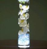 Lámpara debajo florero