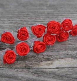 Klemmetjes met rode roosjes