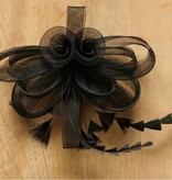 Zwarte corsage met tule en veertjes