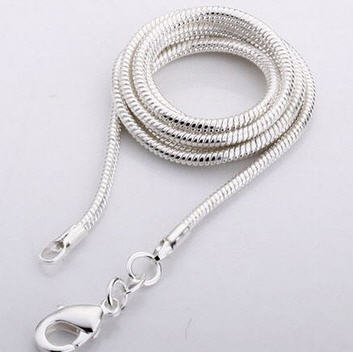 Ametista com pingente de prata, trava de Cartier e saco do presente