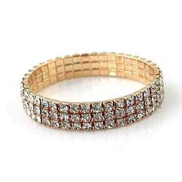 Strass armband elastisch gold