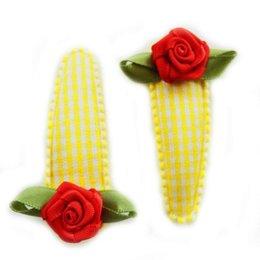 Hippe Knipjes haarknipje geel ruitje rood roosje