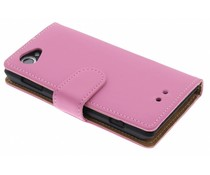 Roze effen booktype hoes Sony Xperia L