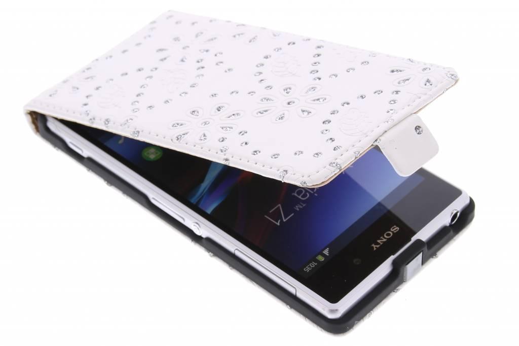 Witte bloemblad design flipcase voor de Sony Xperia Z1