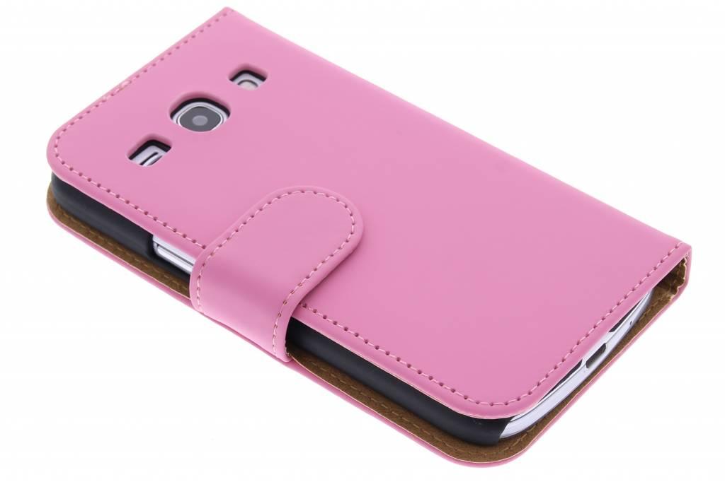 Roze effen booktype hoes voor de Samsung Galaxy Core Plus