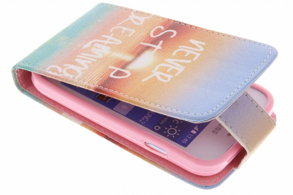 Never stop dreaming design TPU flipcase voor de Samsung Galaxy Young 2