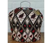 Design Tee-Messe mit speziellen Batik Stoff mit Vogel-Motiv (Hauptfarben schwarz, beige, rot und gelb)