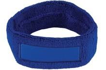 ♣ Goedkope kobaltblauwe badstof hoofdbanden voorzien van een vlak gedeelte (geschikt voor bedrukking of borduring van een logo en/of tekst)