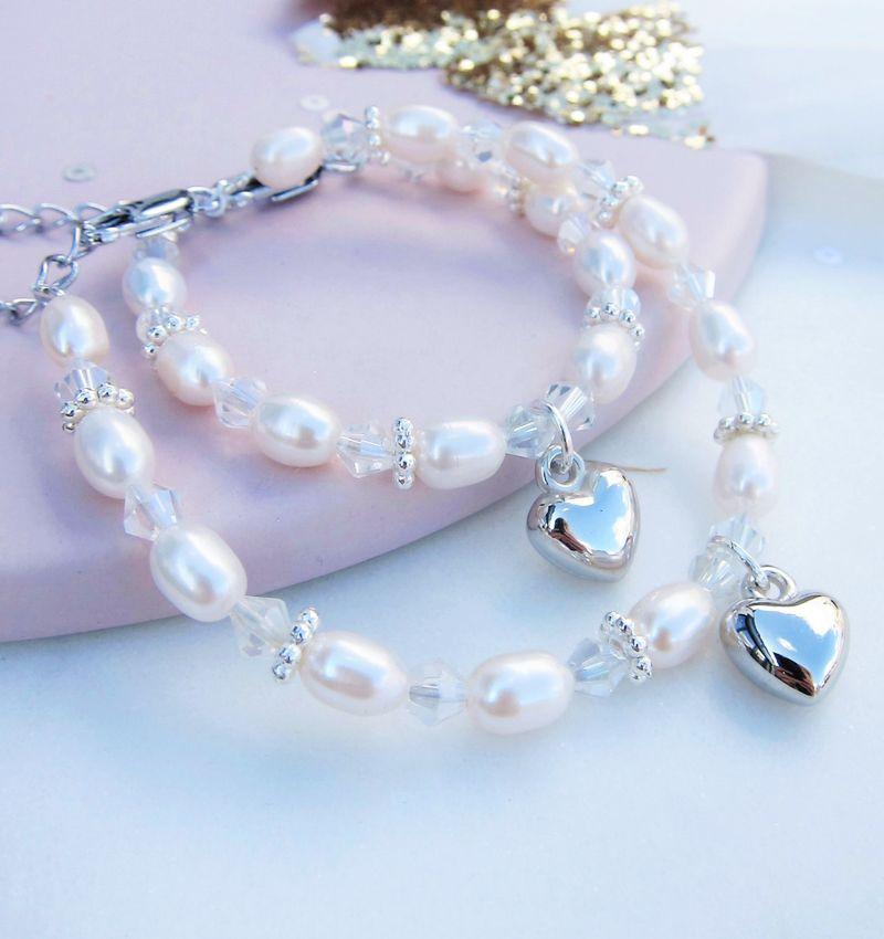 KAYA sieraden Mom & Me armbanden 'Infinity White' met bol hartje