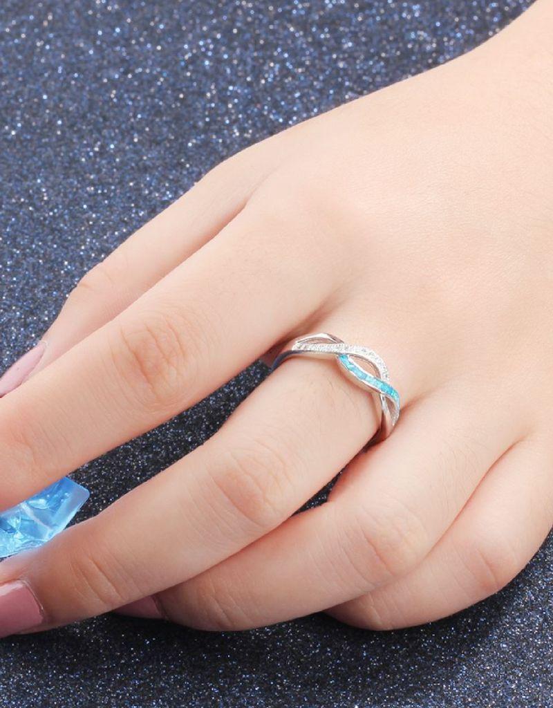 Zilveren ring met opaal steen 'infinity'