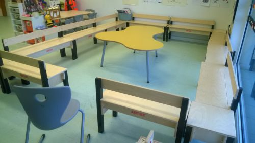 Wooden play furniture in a school classroom