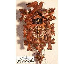 Hettich Uhren Kuckucksuhr mit Quarzwerk  23cm hoch und 18cm breit mit handbemalten Blumen   12 verschiedene Melodien Kuckuck ruft stündlich Kuckuck z.B. 10 Uhr ruft er 10x Kuckuck der Kuckucksruf wird durch ein Echo und ein Wasserfallgeräusch im Hintergrund effektvoll