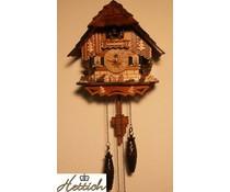 Hettich Uhren Kuckucksuhr 23cm  mit Quarzwerk Holzschindeldach  und automatischer Nachtabschaltung mit 12 verschiedene Melodien mit handgfertigten Holzfiguren