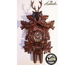 Hettich Uhren Orginal im Schwarzwald  handgefertigte Kuckucksuhr 40cm hoch  mit hangefertigter Jagdstück-Motiv Schnitzerei