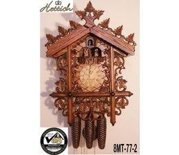 Hettich Uhren Orginal im Schwarzwald handgefertigte Kuckucksuhr mit handgefertigte Figuren und Schnitzerei 52cm hoch und 36cm breit - Copy - Copy