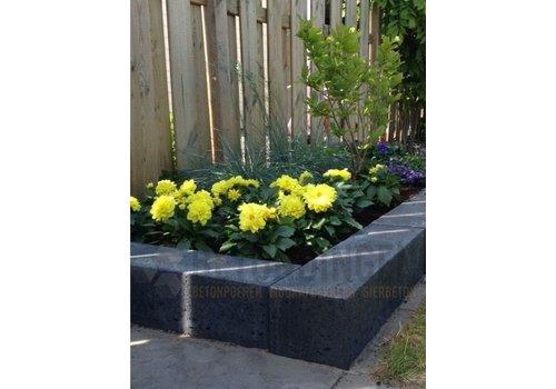 Stapelblokken beton voor een verhoogde border in uw tuin.