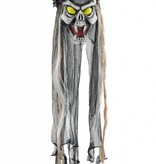Hangende doodskop met groene ogen