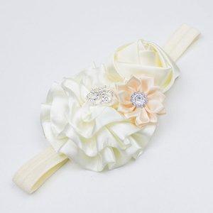 Baby haarbandje met roset/roos/margriet (ivoor)