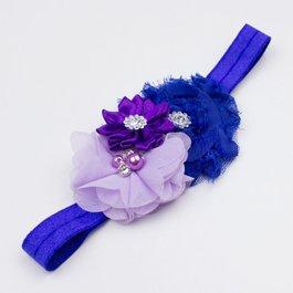 Haarbandje drie bloemen parels/strass paars/blauw/lila