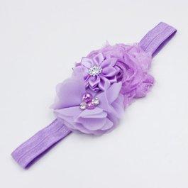 Haarbandje drie bloemen met parels en strass lila
