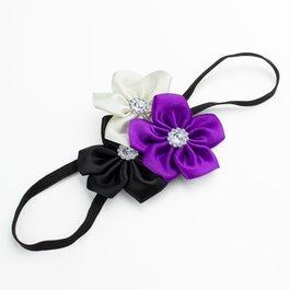Haarbandje drie kleuren bloemen (zwart/paars/wit)