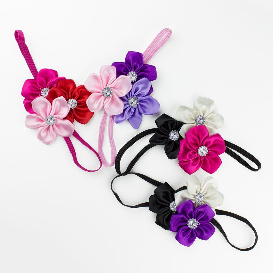 Baby haarbandje drie kleuren bloemen (zwart/paars/wit)