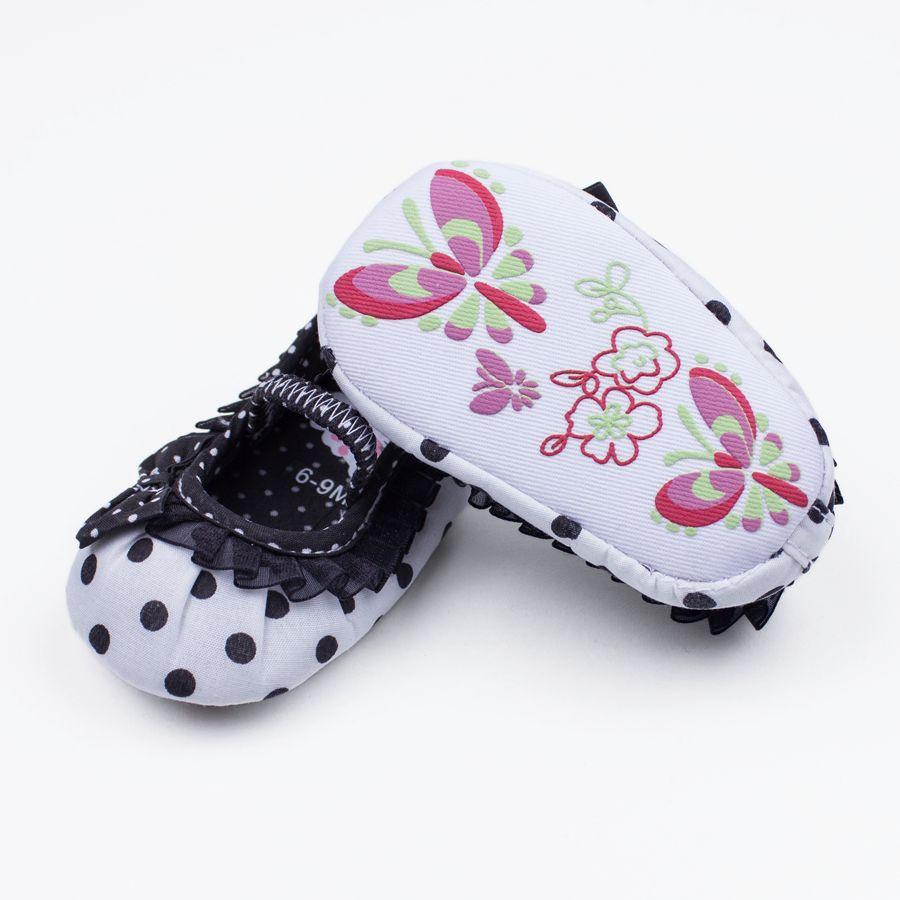 Babyschoenen: witte ballerina's met zwarte stippels