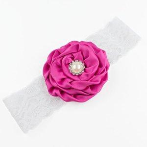 Baby haarbandje bloem met parel op kant (fuchsia)