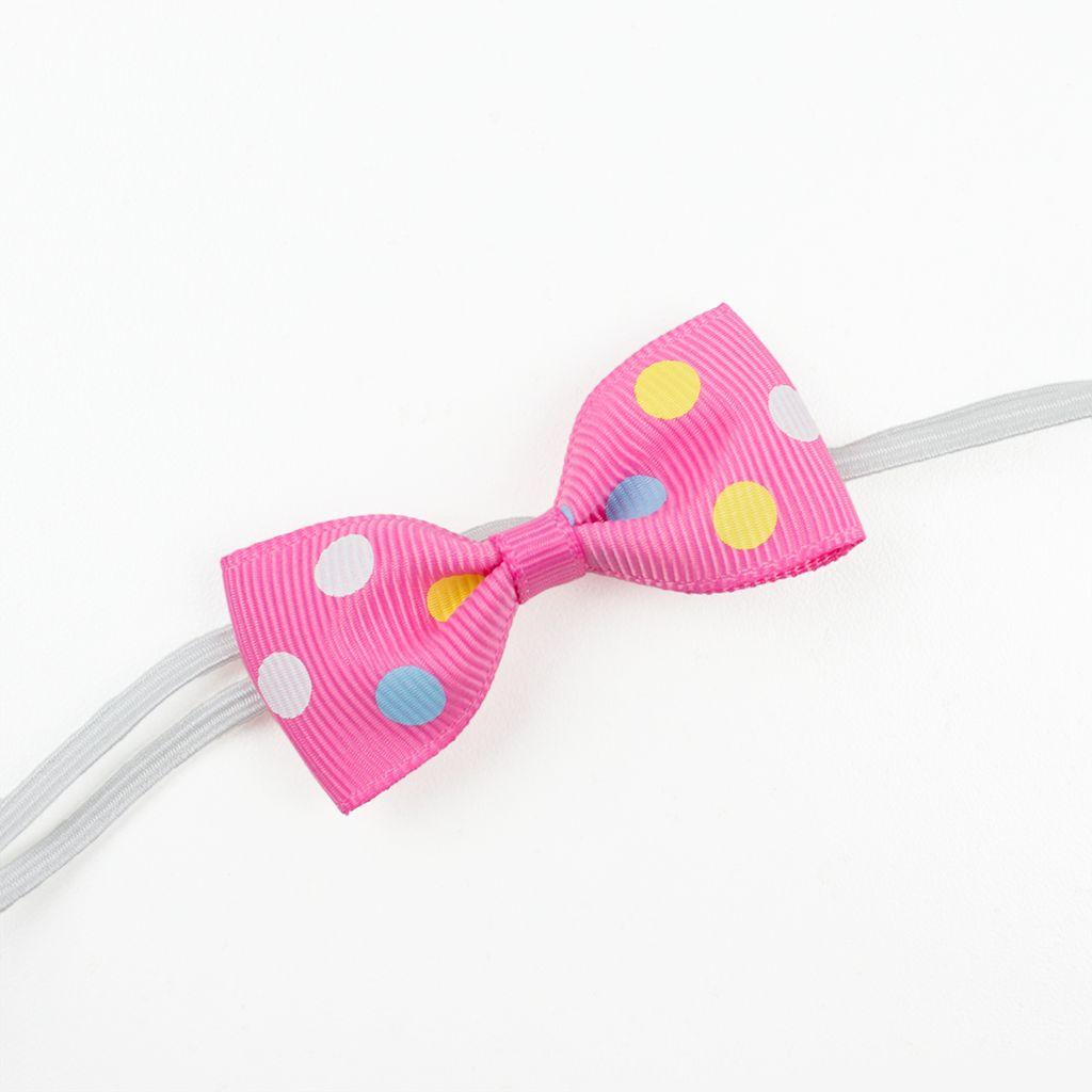 Baby haarbandje met mini strikje (roze stippel)