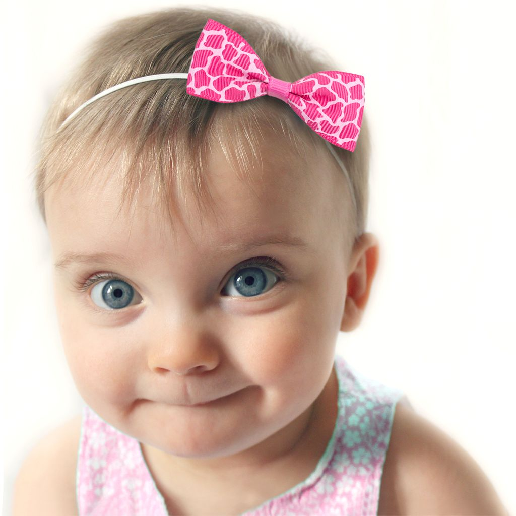 Baby haarbandje met mini strikje (luipaard roze)