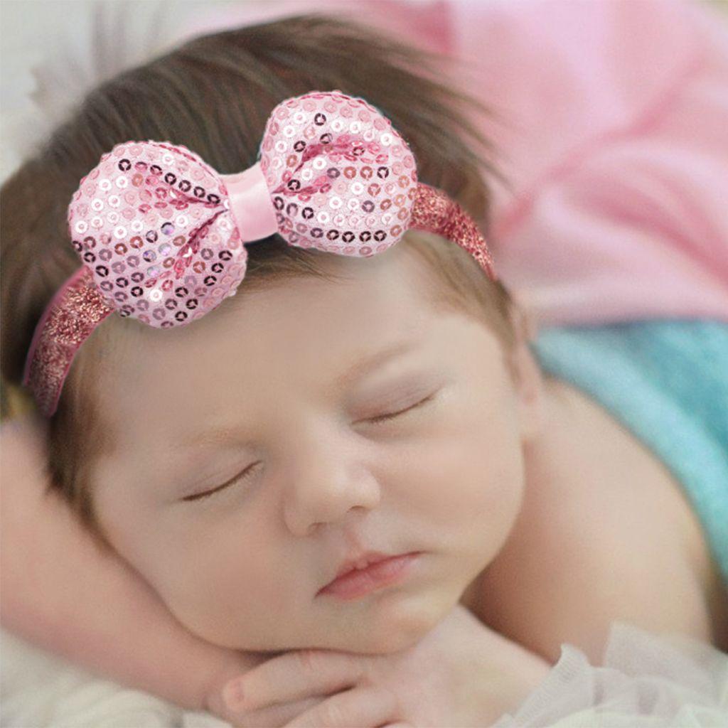 Baby haarbandje strik met glitterpailletjes (goud)