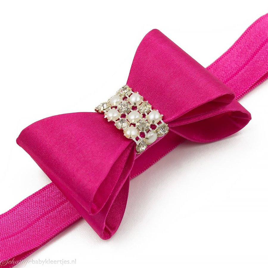 Haarbandje PVC strik met strass en parels (fuchsia)