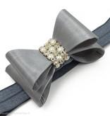 Haarbandje PVC strik met strass en parels (grijs)