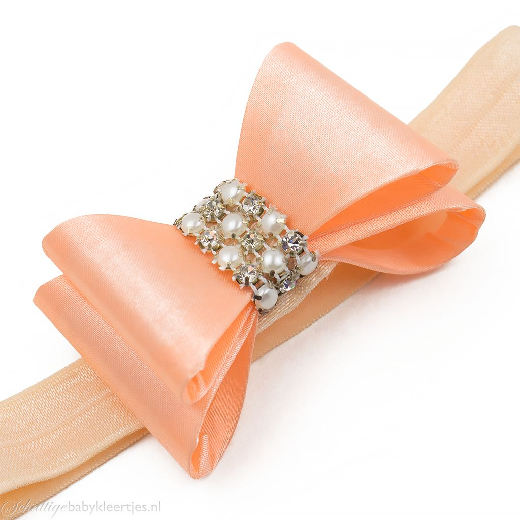 Haarbandje PVC strik met strass en parels (perzik)