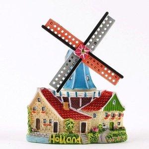Magnet-Mühle bei Häusern