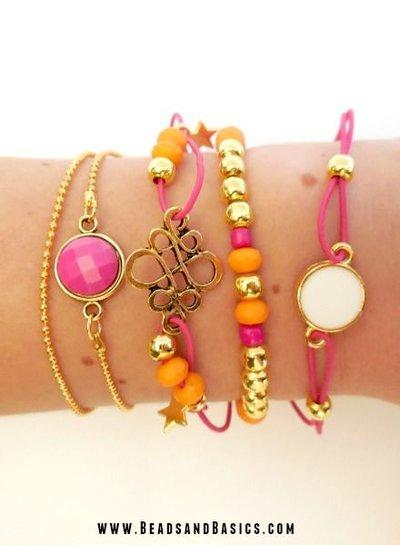 Gold bracelets with pink