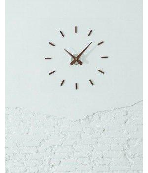 """Nomon Die Wanduhr Holz """"Sunset"""" hat einen Durchmesser von 50 cm, handgefertigt in Spanien"""