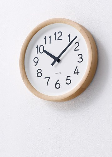 Lemnos Round wooden wall clock available in natural wood or black